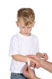 Boy with bandaid Stock Photography