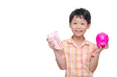 Boy with banknote and piggy bank Stock Image