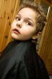 The boy in the barber shop. He gets the hair Royalty Free Stock Images