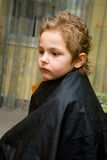 The boy in the barber shop. He gets the hair Stock Photography