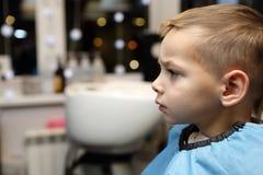 Boy at the barbershop Royalty Free Stock Photo