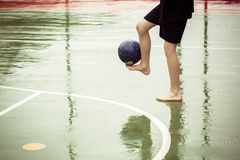 Boy barefoot playing soccer Stock Images