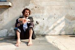 Boy barefoot, thinking Royalty Free Stock Photos