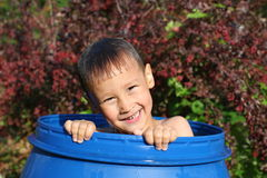 Boy in barrel in water in hot summertime Royalty Free Stock Photos
