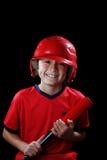 Boy with baseball bat on black background. Smiling young boy with red baseball bat on black background Royalty Free Stock Photos