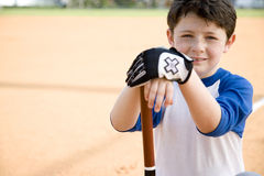 Boy with baseball bat kneeling Royalty Free Stock Images