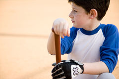 Boy with baseball bat kneeling Royalty Free Stock Photos