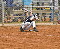 Boy Baseball Batter. A young boy at bat ducking away from the ball as it comes close to his head stock photos