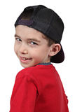 Boy in baseball cap Stock Image