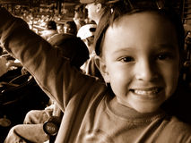 Boy at baseball game. Boy eating at baseball game Royalty Free Stock Photography
