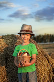 Boy with basket of buns Royalty Free Stock Photography