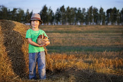 Boy with basket of buns Royalty Free Stock Image