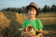 Boy with basket of buns i Stock Photos