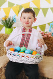 Boy with a basket Stock Images