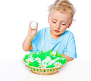 Boy with a basket of eggs Stock Photo