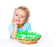 Boy with a basket of eggs Royalty Free Stock Photos