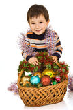 Boy and basket with New Year's toys Royalty Free Stock Photography