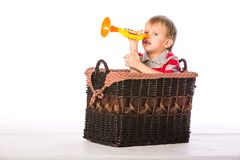 Boy in basket with toy Stock Photography