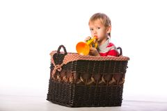 Boy in basket with toy Stock Photo