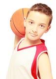 Boy with basketball. Teen boy with a basketball sports Stock Photos