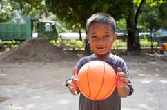 Boy and basketball Royalty Free Stock Photography