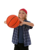 Boy with Basketball. Cute young boy ready to throw a basketball, isolated on white background Stock Photo