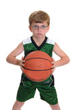 Boy with basketball. In an agressive stance Royalty Free Stock Images