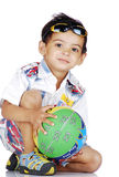 Boy with basketball. Boy giving pose wearing goggles on head Royalty Free Stock Photography