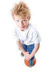 The boy with a basketball ball. On a white background stock photography