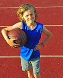 Boy with a basketball outdoors Stock Photography