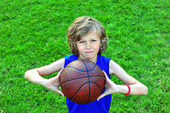 Boy with a basketball outdoors Royalty Free Stock Image