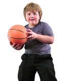 Boy, basketball player makes a throw with a ball Royalty Free Stock Photo