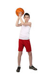 Boy basketball player. Boy in sleeveless shirt and sport shorts going to throw a basketball ball full height isolated on white background Stock Photos