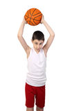 Boy basketball player. Boy in sleeveless shirt and sport shorts throwing a basketball ball isolated on white background Stock Photo