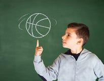 Boy and basketball Stock Photos