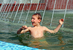 Boy bath in fountain Royalty Free Stock Image