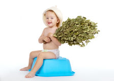 Boy with bath hat and broom Stock Photo