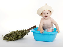 Boy with bath hat and broom Royalty Free Stock Photography