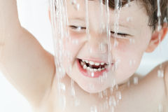 Boy in Bath Playing with Water Stock Image