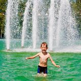 The boy bathes in a fountain Royalty Free Stock Image