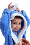 The boy after bathing. Mum cares of the little boy in a dressing gown after bathing Stock Photo