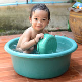 Boy bathing. Baby boy (1 year) bathing outdoors royalty free stock photo