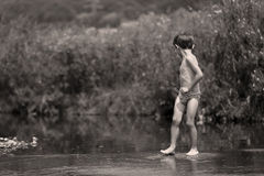 Boy bathing in the lake, summer time fun royalty free stock photo