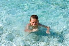Boy bathing in the sea (Greece). Stock Photo