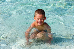 Boy bathing in the sea. (Greece). Royalty Free Stock Images