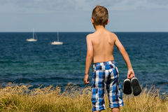 Boy with bathing shoes Royalty Free Stock Images