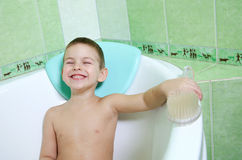 The boy in the bathroom. With an excellent mood, the completion of water treatments Royalty Free Stock Photo