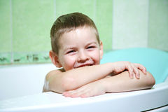 The boy in the bathroom. With an excellent mood, the completion of water treatments Stock Image