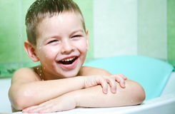 The boy in the bathroom. With an excellent mood, the completion of water treatments Stock Photography