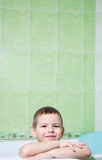 The boy in the bathroom. With an excellent mood, the completion of water treatments Stock Photo